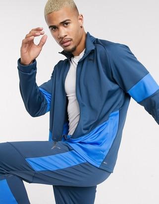 Puma colour block zip thru top in blue
