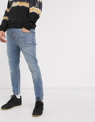 ASOS DESIGN ankle grazer skinny jeans in light wash blue