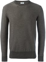 Closed knitted crew neck sweater