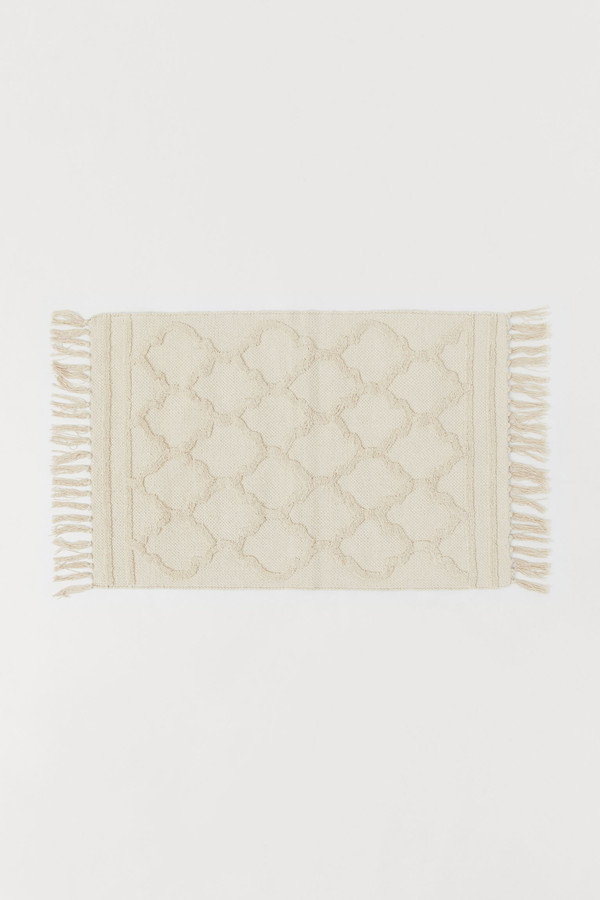 H&M Small tasselled rug