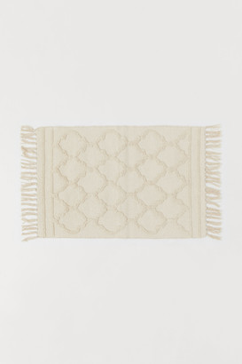 H&M Small Tasseled Rug