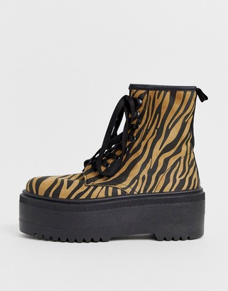 Asos DESIGN Acton chunky lace up boots in tan zebra print