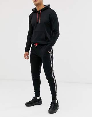 HUGO x Liam Payne side tape joggers in black