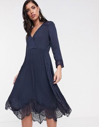 Liquorish wrap dress with pleated skirt and lace hem