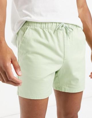 ASOS DESIGN slim chino shorter shorts with elastic waist in pastel green