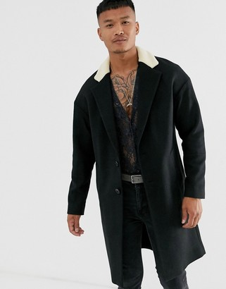 Religion drop shoulder overcoat with borg collar in black
