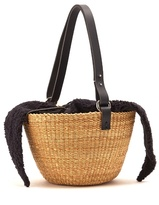 Muun Egg faux-shearling and woven-straw bag
