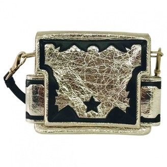 Givenchy Gold Patent leather Handbags