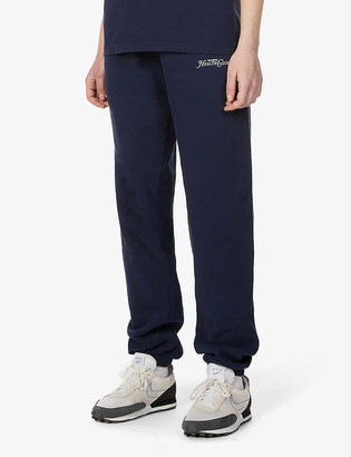 Sporty & Rich Rizzoli branded tapered mid-rise cotton-jersey jogging bottoms