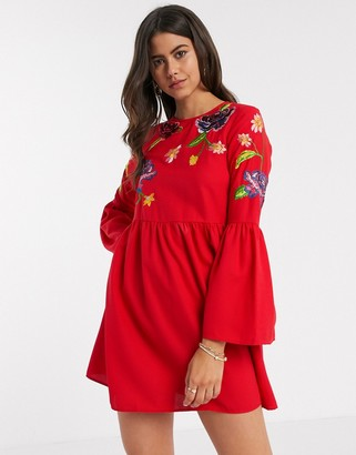 ASOS DESIGN fluted sleeve embroidered smock mini dress in red