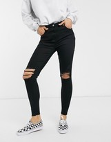 Parisian skinny jeans with distressed knee rips