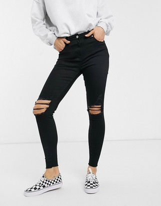 Parisian skinny jeans with distressed knee rips-Black