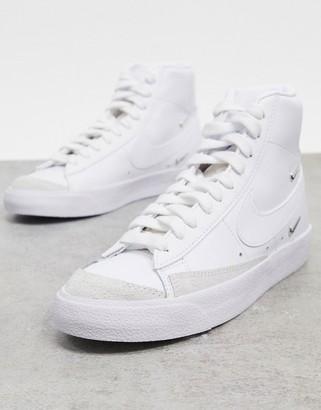 Nike Blazer Mid 77 trainers with metallic mini swoosh in white