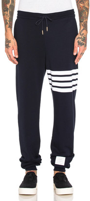Thom Browne Cotton Sweatpants in Navy | FWRD