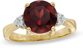 Zales 9.0mm Garnet and Diamond Accent Ring in 10K Gold