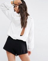 Billabong Long Sleeve Wrap Back Top With Ladder Inserts And Shoulder Stud Detail Stud Detail