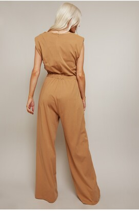 Little Mistress Aga Jersey Jumpsuit With Shoulder Pads And Cowl Neckline