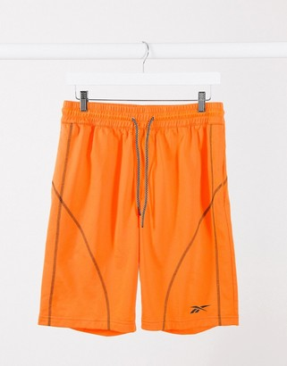 Reebok Training seam detail sweat shorts in orange
