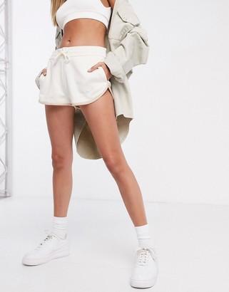 Nike runner shorts in cream