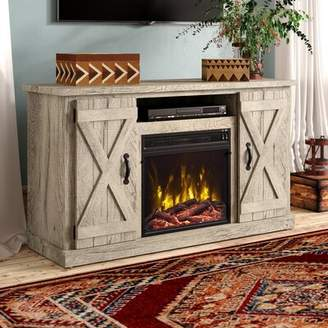 Laurèl Foundry Modern Farmhouse Leisa TV Stand for TVs up to 55 inches with Electric Fireplace Included Foundry Modern Farmhouse Color: Ashland Pine