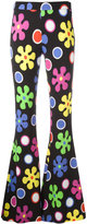 Moschino flower power flared trousers - women - Rayon/other fibers - 38