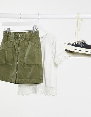 Pimkie zip front mini skirt in green