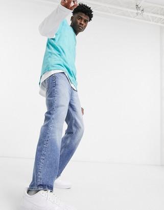 ASOS DESIGN bootcut jeans in dark blue 90s wash