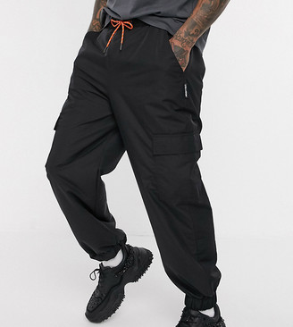 Collusion nylon cargo trousers with pockets in black