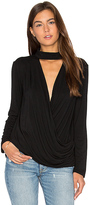 Krisa Surplice Turtleneck Top