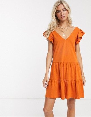 ASOS DESIGN v neck frill sleeve tiered smock dress in rust