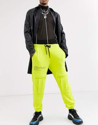 Asos Design DESIGN cargo joggers in washed neon with text print-Navy
