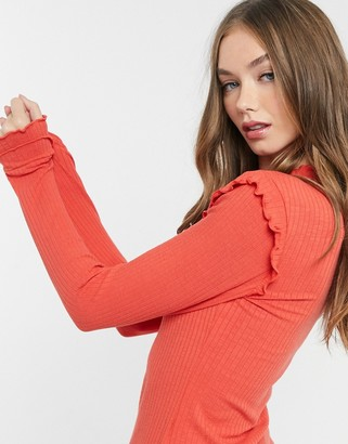 Pieces ribbed top with high neck and lettuce hem trims in red
