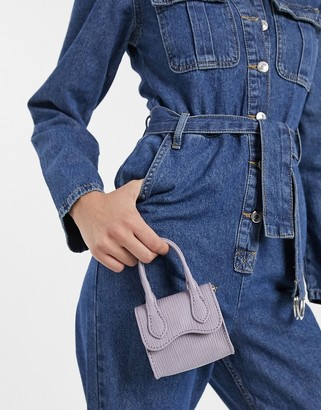 Asos DESIGN grab bag with curved flap and detachable strap in lilac lizard
