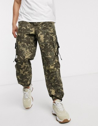 ASOS DESIGN wide leg cargo pants in camo print