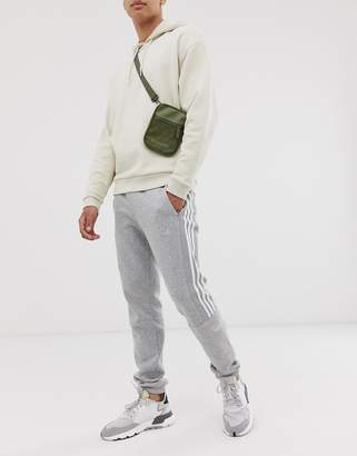 adidas joggers with trefoil print in grey