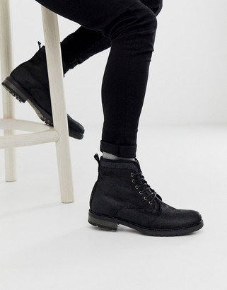 Asos DESIGN lace up work boots in black leather with faux shearling lining