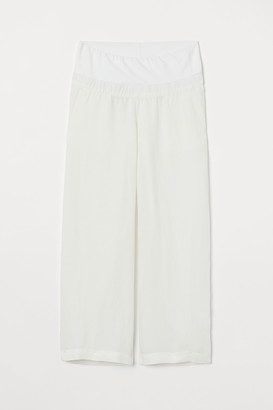 H&M MAMA Wide linen-blend trousers