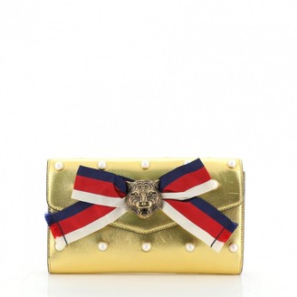 Gucci Animalier Gold Leather Clutch bags