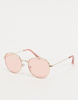 ASOS DESIGN round sunglasses in gold with light pink lens