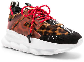 Versace Calf Hair Chain Reaction Sneakers in Black & Red Print | FWRD