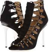 jennifer lopez  Who made  Jennifer Lopezs black leather fringe handbag, studded jewelry, and tan lace up sandals?