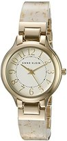 Anne Klein Women's AK/2380WTGB Easy To Read Gold-Tone and White Resin Bangle Watch