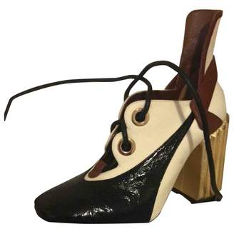 Christian Dior Gold Leather Ankle boots