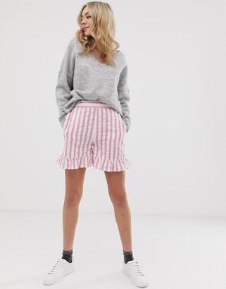 ASOS DESIGN pink stripe shorts with ruffle hem