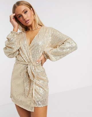 Club L London Club L sequin long sleeve wrap mini dress in gold