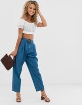 Asos Design DESIGN soft peg lightweight jeans with self belt in vintage blue wash