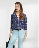 Express lipstick print long sleeve zip front blouse