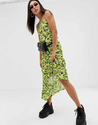 New Girl Order asymmetric maxi dress with frill hem in tattoo repeat print