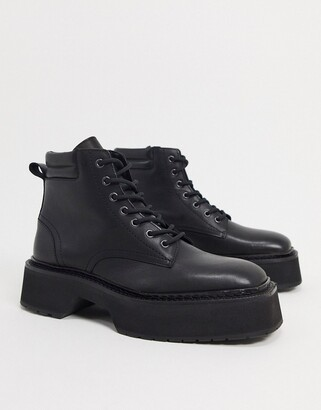 ASOS DESIGN lace up boots in black high shine leather on chunky sole