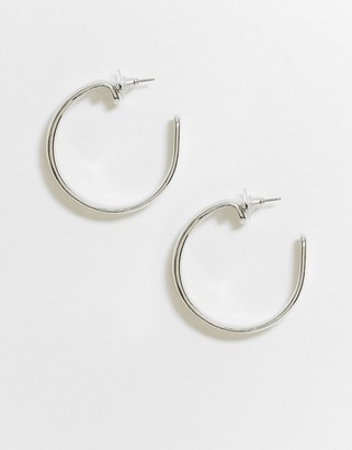 ASOS DESIGN hoop earring in abstract curl design in silver tone
